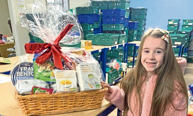 Catherine Letford with her donations.