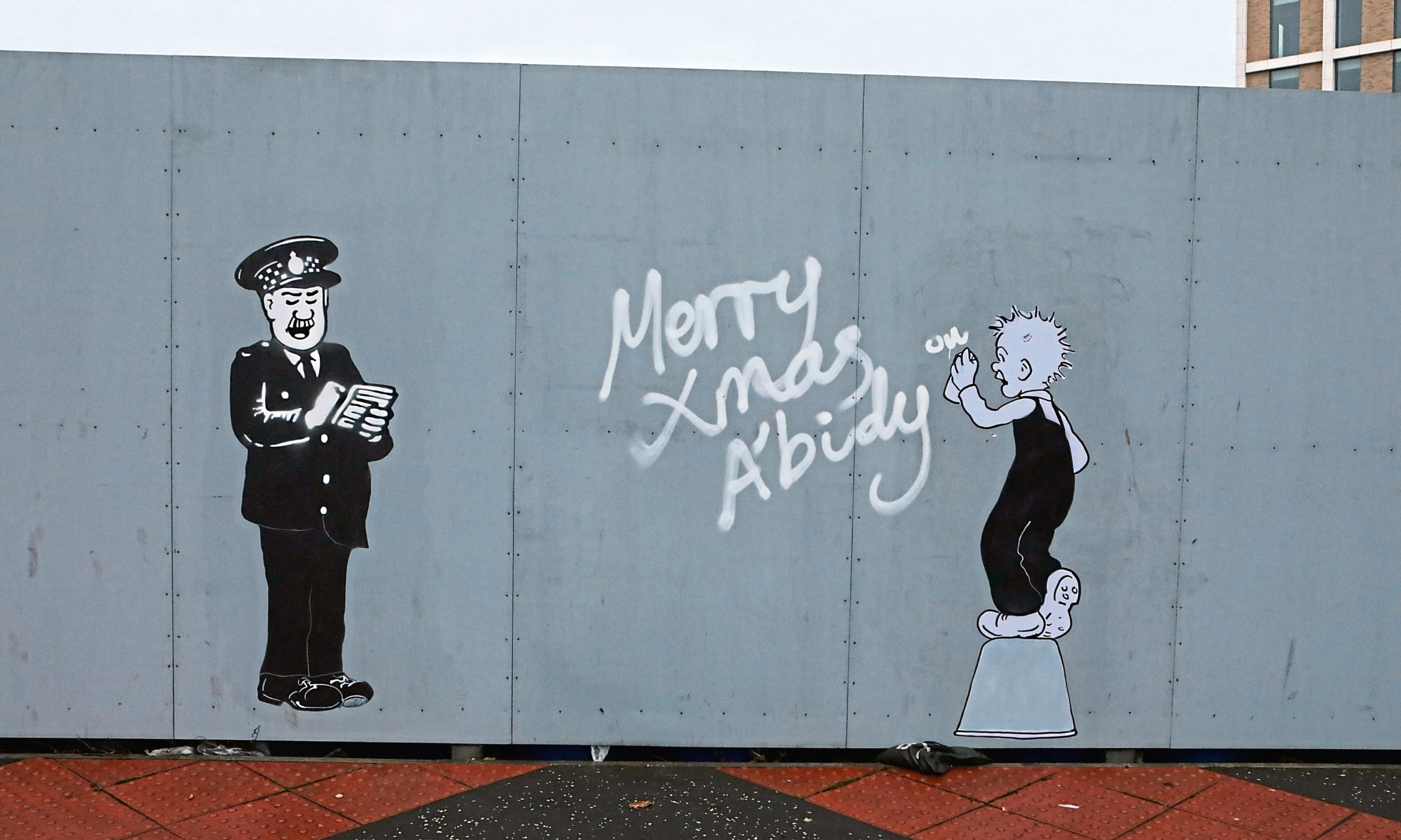 The Oor Wullie and PC Murdoch drawings on Whitehall Street.