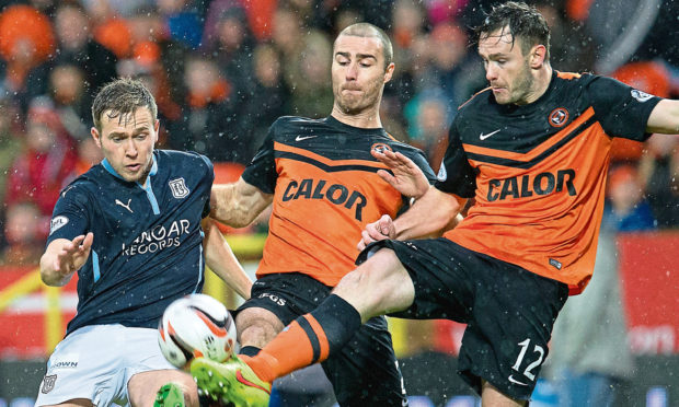 Dundee's Greg Stewart does battle with Sean Dillon (centre) and Keith Watson (right).