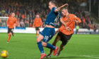 Jamie Robson of Dundee United challenges Dundee's Paul McGowan.
