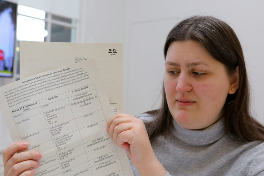 Jennifer Grimes with her paperwork relating to her chronic pain.