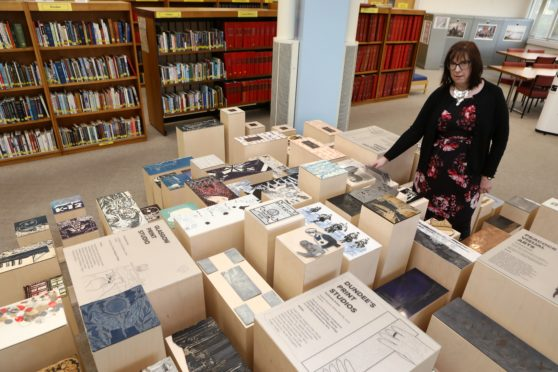 Tele News - Dundee story - WW1 Exhibition.  CR0017553 Picture shows; Maureen Hood - Information Services Manager Central Library, beside the art installation depicting World War 1, at the Central Library today. Friday 13th December 2019. Dougie Nicolson / DCT Media.