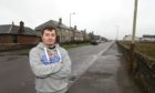 Forrest Haxton on East Muirlands road Arboath at the spot where his BMW was the victim of a hit and run.