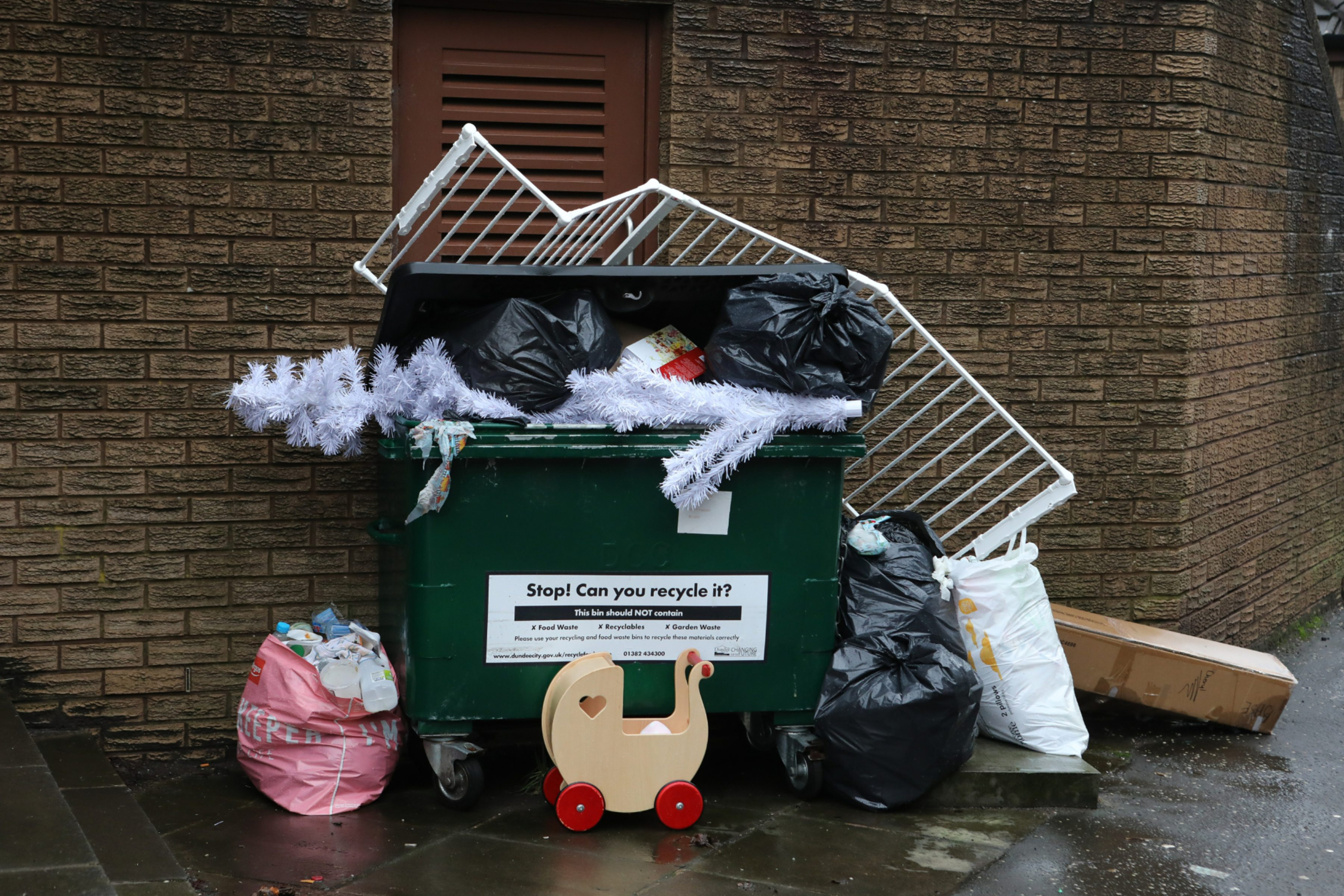 Overflowing bins in Victoria Street.