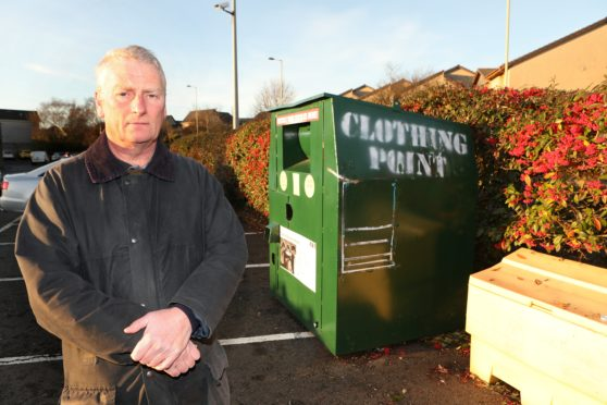 Cllr Craig Duncan at the recycling bins in Campfield Square Barnhill where people having been fly tipping.