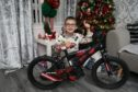 Carson Ross is gifting his bike to another family.