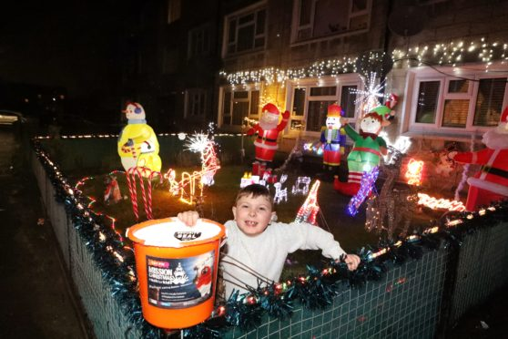 Evening telegraph news CR0017079 G Jennings pics, Louise Berty of Balmoral Place has decorated the front garden for xmas ,collecting for Cash for Kids, her son Alfie is in the garden with a collecting bucket, monday 2nd december.