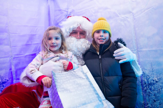 Santa - l to r - Skye (4) and Sophie (9), Bractullo Farm, Letham, Angus,