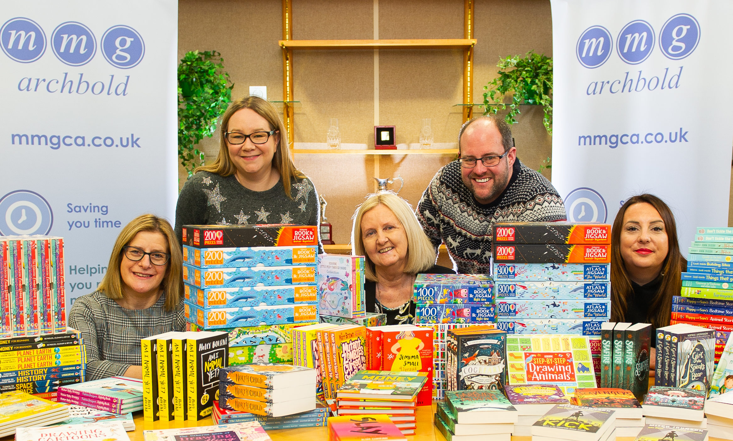 Telegraph News – Dundee – Sarah Williamson story - CR0017588 - Help for Kids have received over £1,500 worth books for children this Christmas. Picture being taken at MMG Archibald who donated money for Fiona to get the books. Picture Shows;  l to r - Wilma Anderson (MMG Archbold), Fiona Sivewright (Usborne Books), Aileen Bollan (MMG Archbold), Derek Millar (Trustee Help for Kids) and Hannah Kemlo (Help for Kids), MMG Archbold, Chapelshade House, Bell Street, Dundee, 16th December 2019 – Kim Cessford / DCT Media