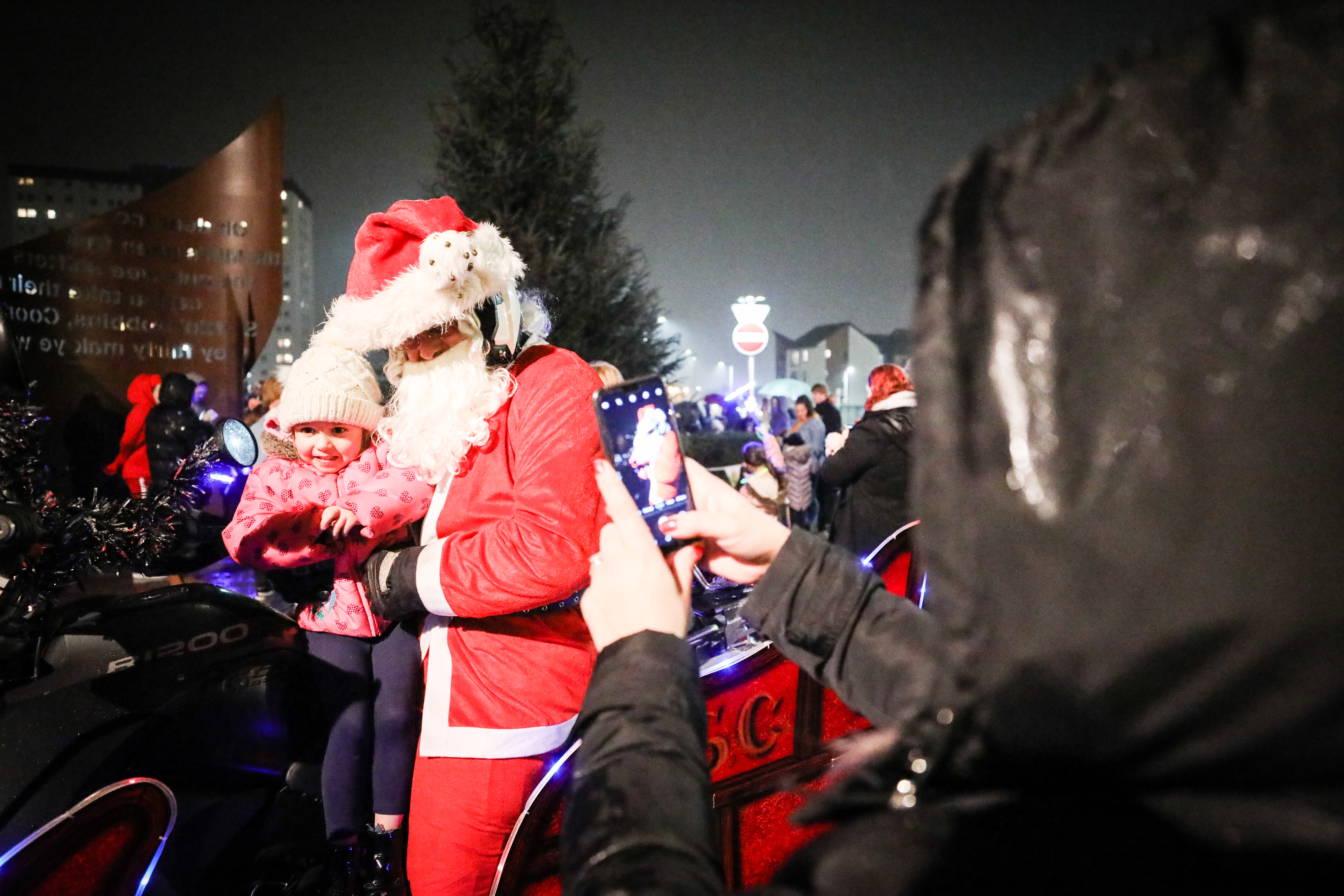 Last year's Christmas light switch on in Lochee. Santa is pictured with three-year-old Stevie Flynn.