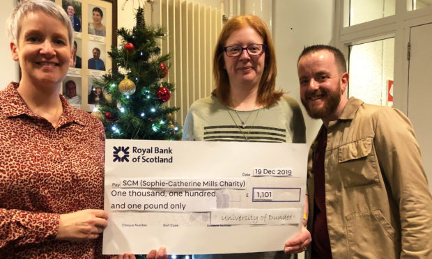 Jill Webster University of Dundee Chapliancy Centre presents a cheque to Jenny and Paul Mills of SCM.