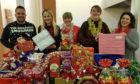 Overgate's Karen Michie, centre, with Dundee Foodbank volunteers.