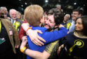 First Minister Nicola Sturgeon celebrates with supporters at the SEC Centre in Glasgow.