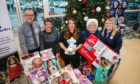 From left, Tesco South Road manager James Dunn, riverside community champion Allison Yeaman, Hannah Kemlo from Help for Kids, Ruby Young from Kingsway Tesco and Lisa Small from South Road Tesco, launch the Help for Kids Christmas Appeal at Tesco Extra.