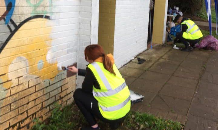 Volunteers painting the toilet block at Clatto in December last year.