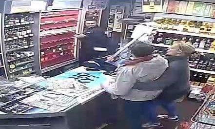 The man is seen on CCTV brandishing a metal pole.
