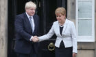 Scotland's First Minister Nicola Sturgeon with Prime Minister Boris Johnson in Bute House in Edinburgh.