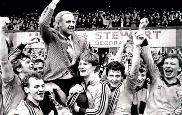 Jim McLean is lifted up by his players after securing the Premier League in 1983.
