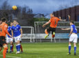 Mark Connolly heads home the opening goal at Palmerston.