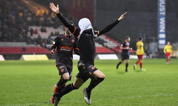 Lawrence Shankland celebrates making it 4-0 to Dundee United and completing his perfect hat-trick.