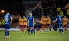 Motherwell celebrate their third goal.
