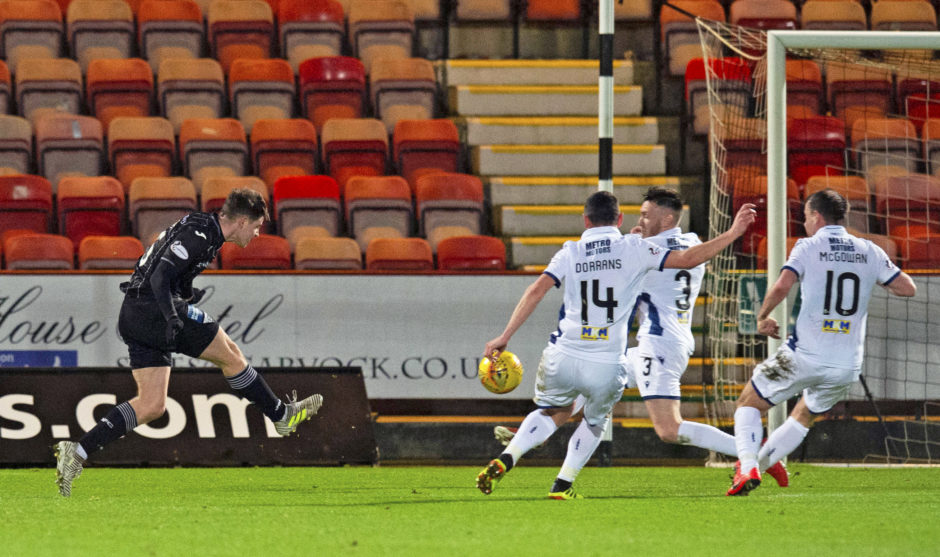 Kevin Nisbet curls home to make it 2-0 to the home side.