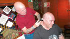Scott shaves off Bob's hair at The Vault bar.