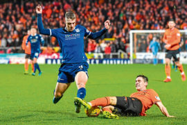 Dundee United right-back Liam Smith tackles Dundee striker Andrew Nelson in December's derby draw at Tannadice.