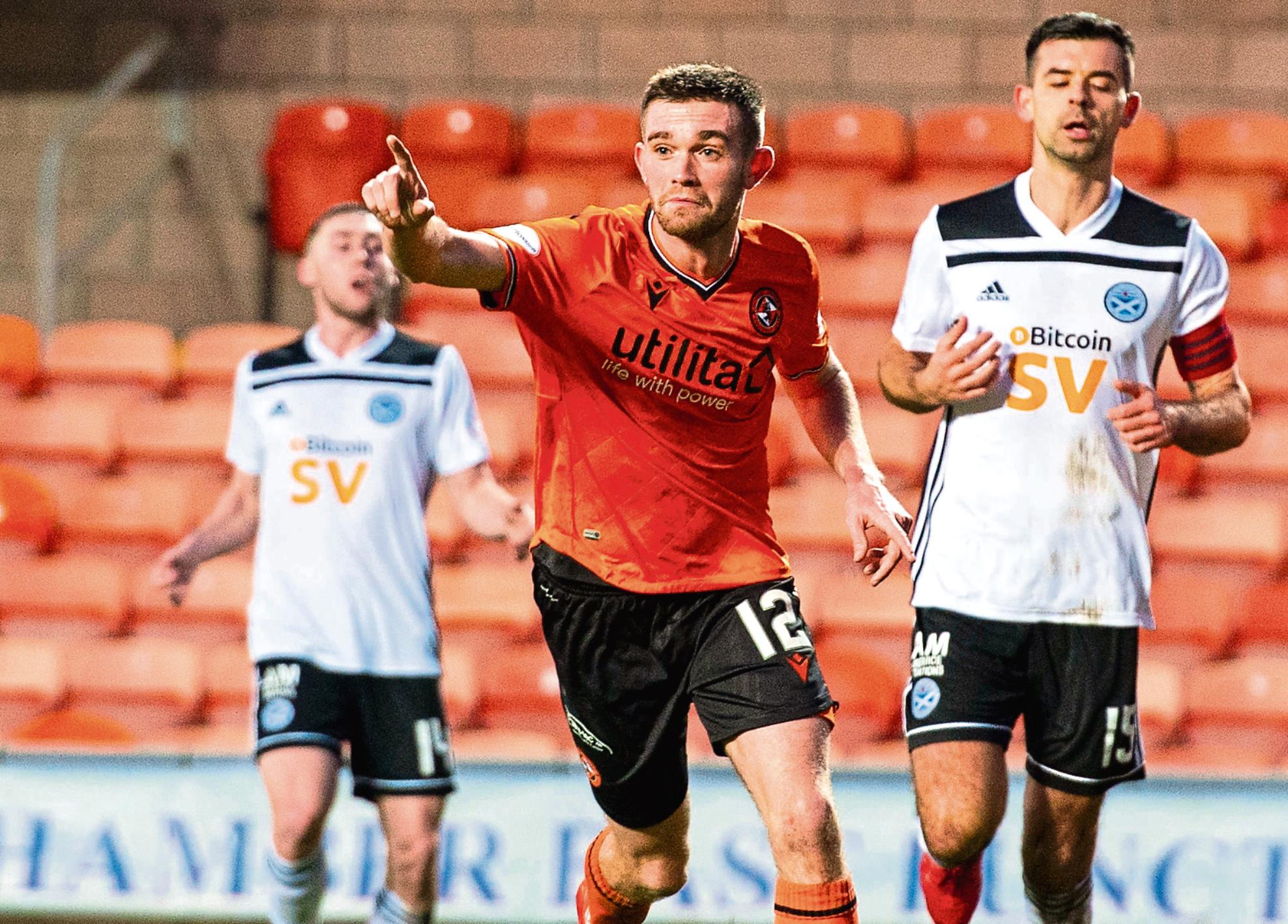 Dundee United midfield man Sam Stanton celebrates scoring against Ayr United.
