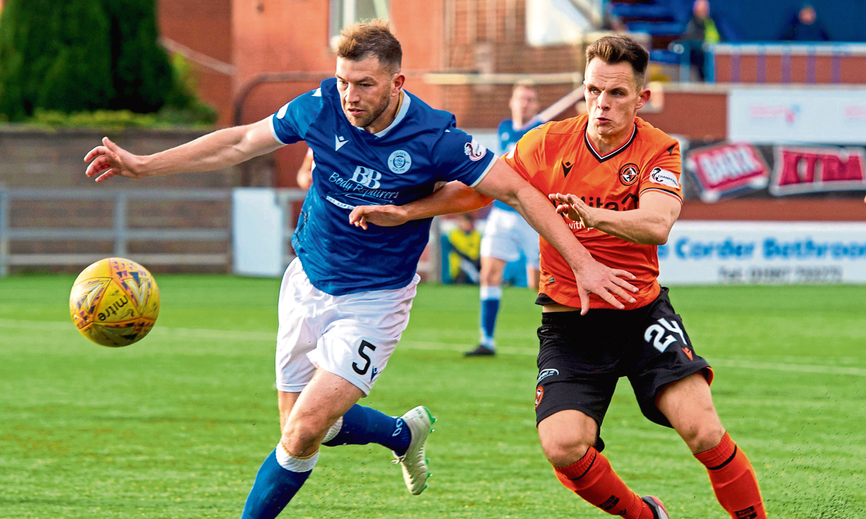 Dundee United's Lawrence Shankland (right) competes with Darren Brownlie in October.