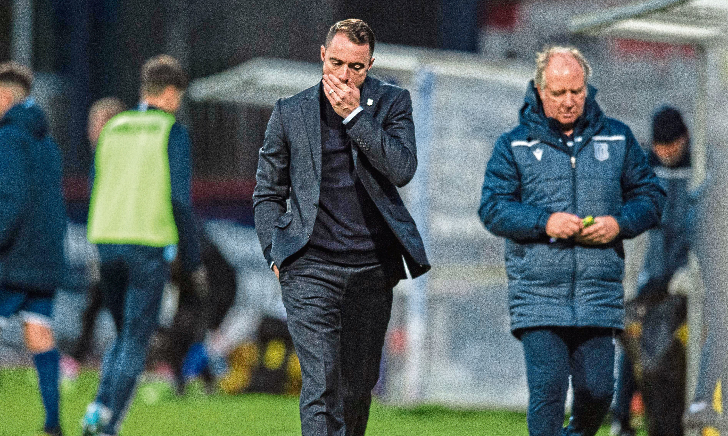 James McPake cuts a forlorn figure at half-time at Dens Park on Saturday.