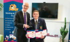 Eastern Primary pupil Ed Yorke and Deputy First Minister John Swinney. Ed won a Sumdog Scotland competition for the third time.