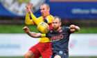 Kenny Miller, left, competes with Dundee United's Mark Reynolds.