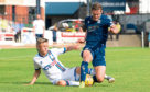 Inverness's Roddy MacGregor and Dundee's Josh Todd in action.