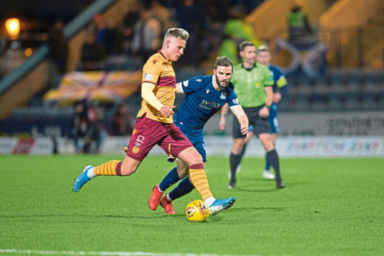 Jamie Ness in action for Dundee before coming off in Saturday night's 3-0 Scottish Cup fourth-round defeat to Motherwell at Dens.