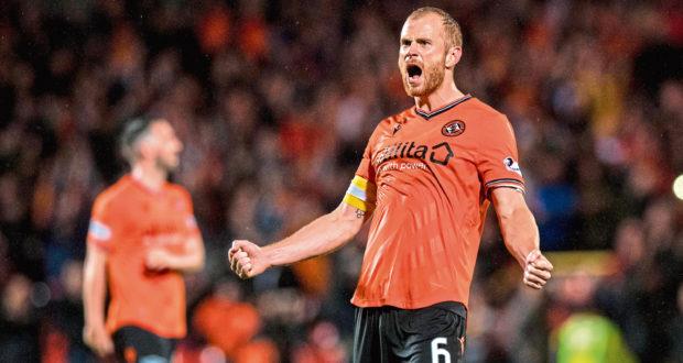 Dundee United skipper Mark Reynolds celebrates their 6-2 derby win last season.