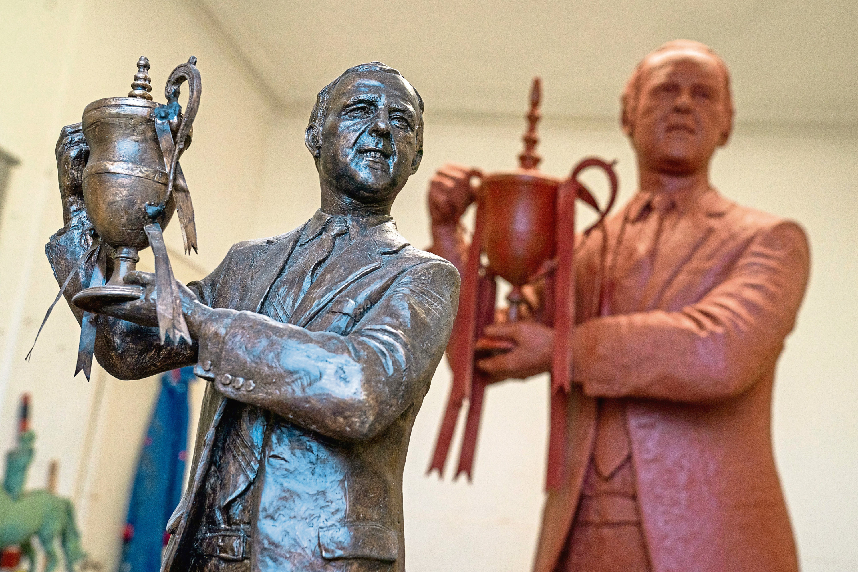 A completed maquette of the statue of Dundee Utd Legend Jim McLean stands in front of the statue which is ready now to be bronzed. Artist Alan Herriot has been commissioned to create the Statue which will take pride of place outside Tannadice once complete. CR0018645 Pic Kenny Smith, Kenny Smith Photography Tel 07809 450119