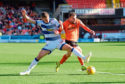 Luca Colville (L) and Paul McMullan compete during the match between Dundee United and Greenock Morton.
