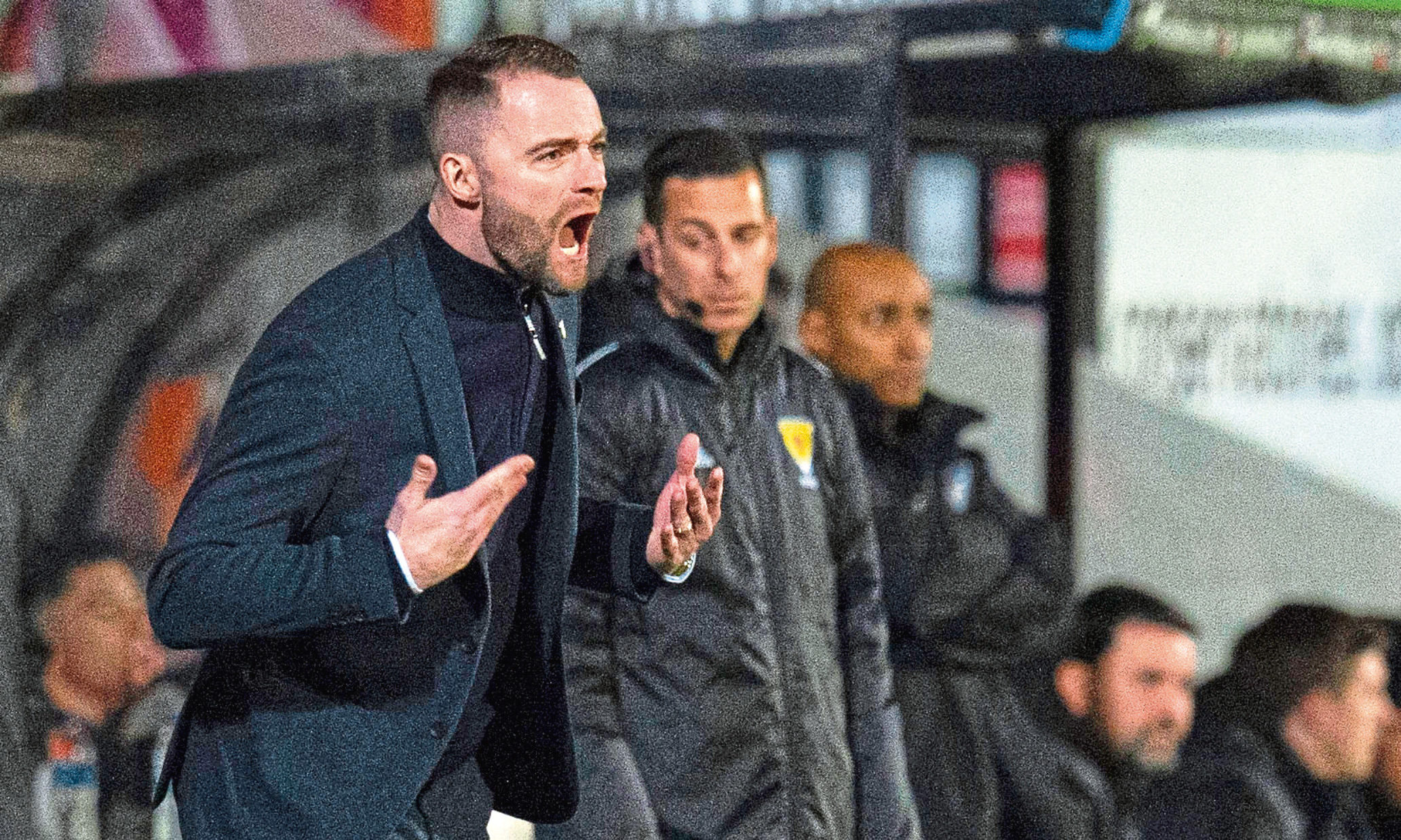 Dundee manager James McPake screams instructions from the bench during Dundee's loss to Dunfermline.