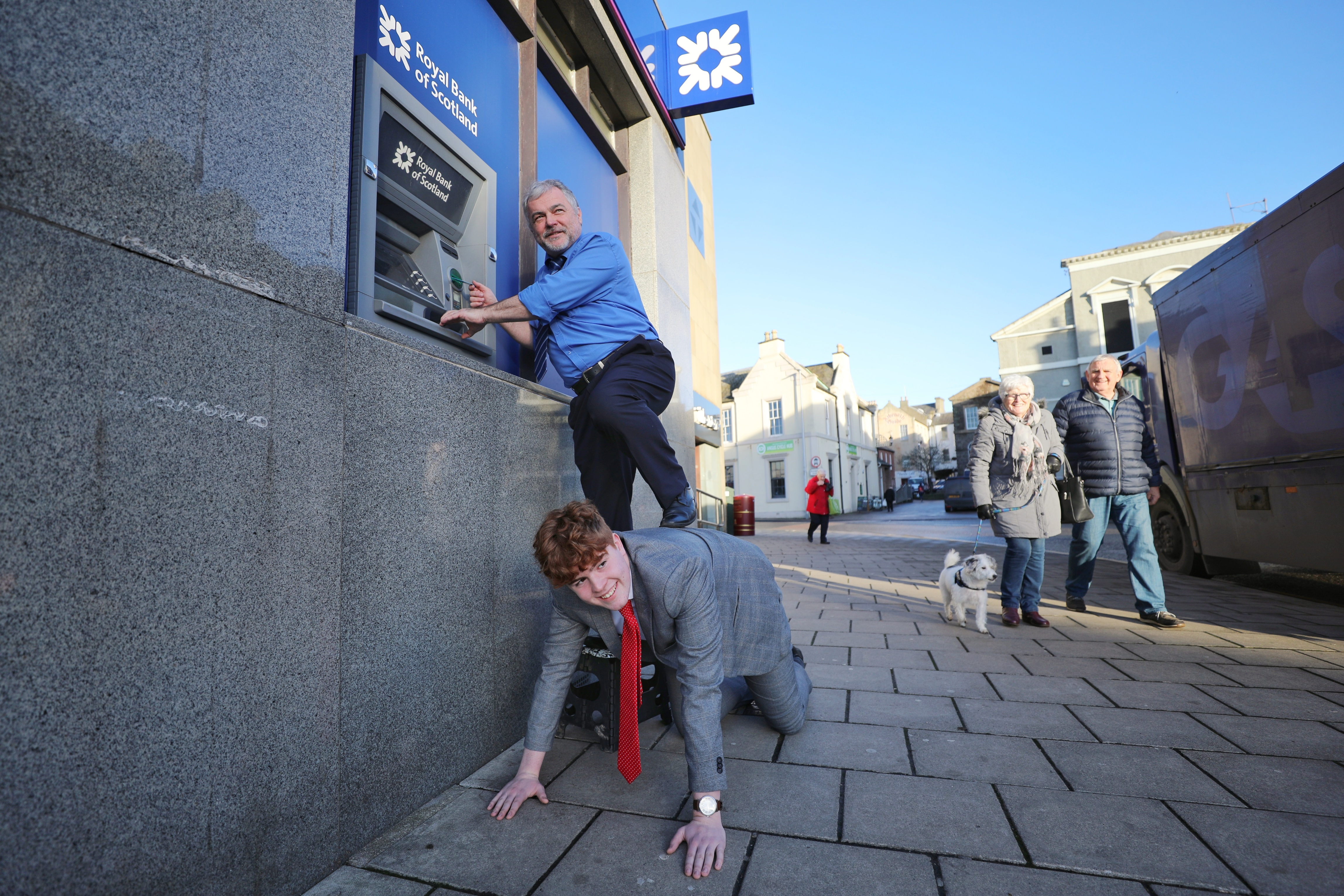 Tele reporters Kenny MacDonald and Matteo Bell attempting to use the cash machine.
