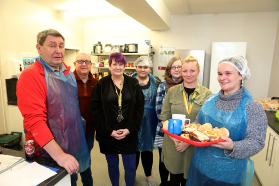 Haven manager Niki Lamond (second from right) with her volunteers in the kitchen.