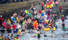 The swimmers take to the water, Broughty Ferry on New Year's Day 2020. Kim Cessford / DCT Media.