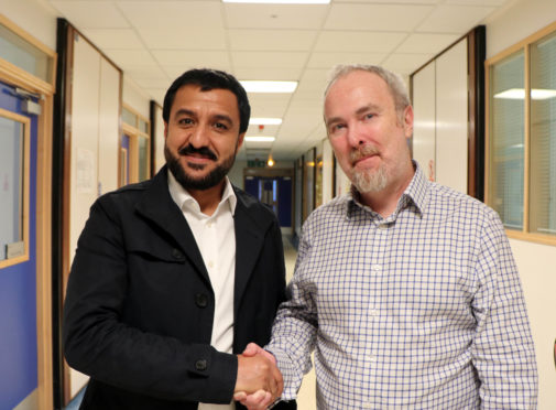 Image shows Dr Amir with Professor Palmer.