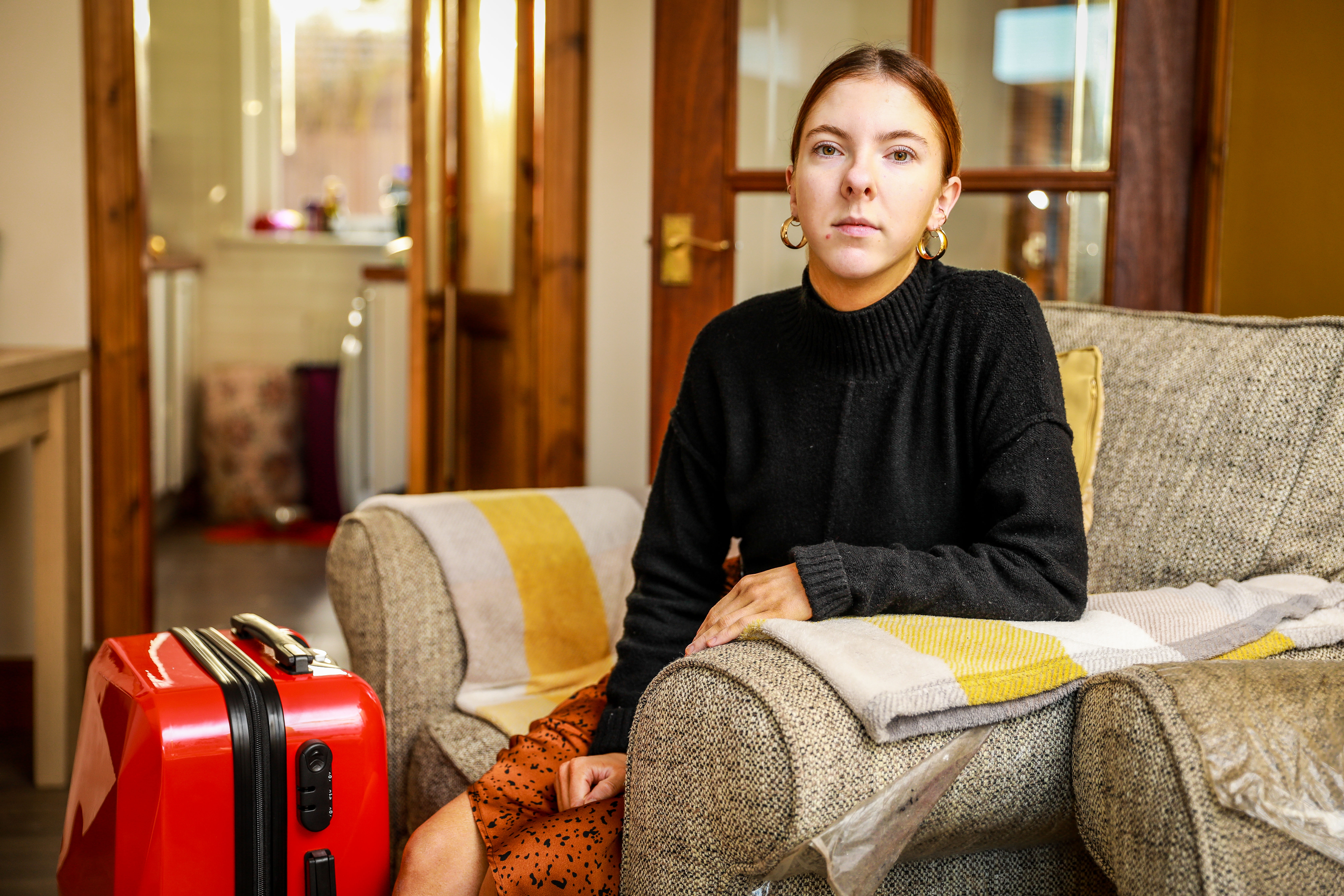 Charlotte Doig at home in Dundee with a case similar to the one that she lost.