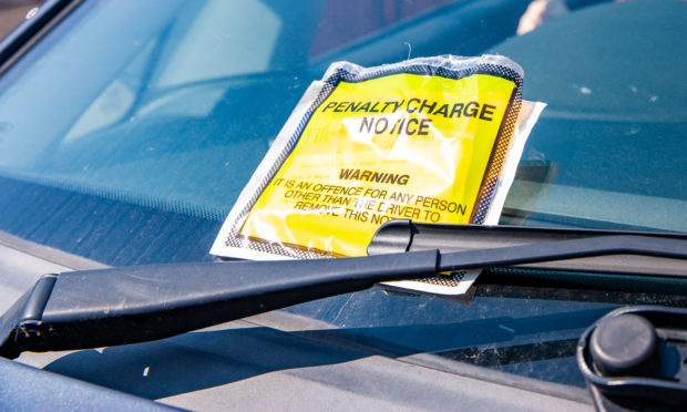 Dundee City Council has failed to collect on thousands of overdue parking fines.