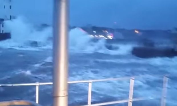 The waves battered Arbroath Harbour yesterday.