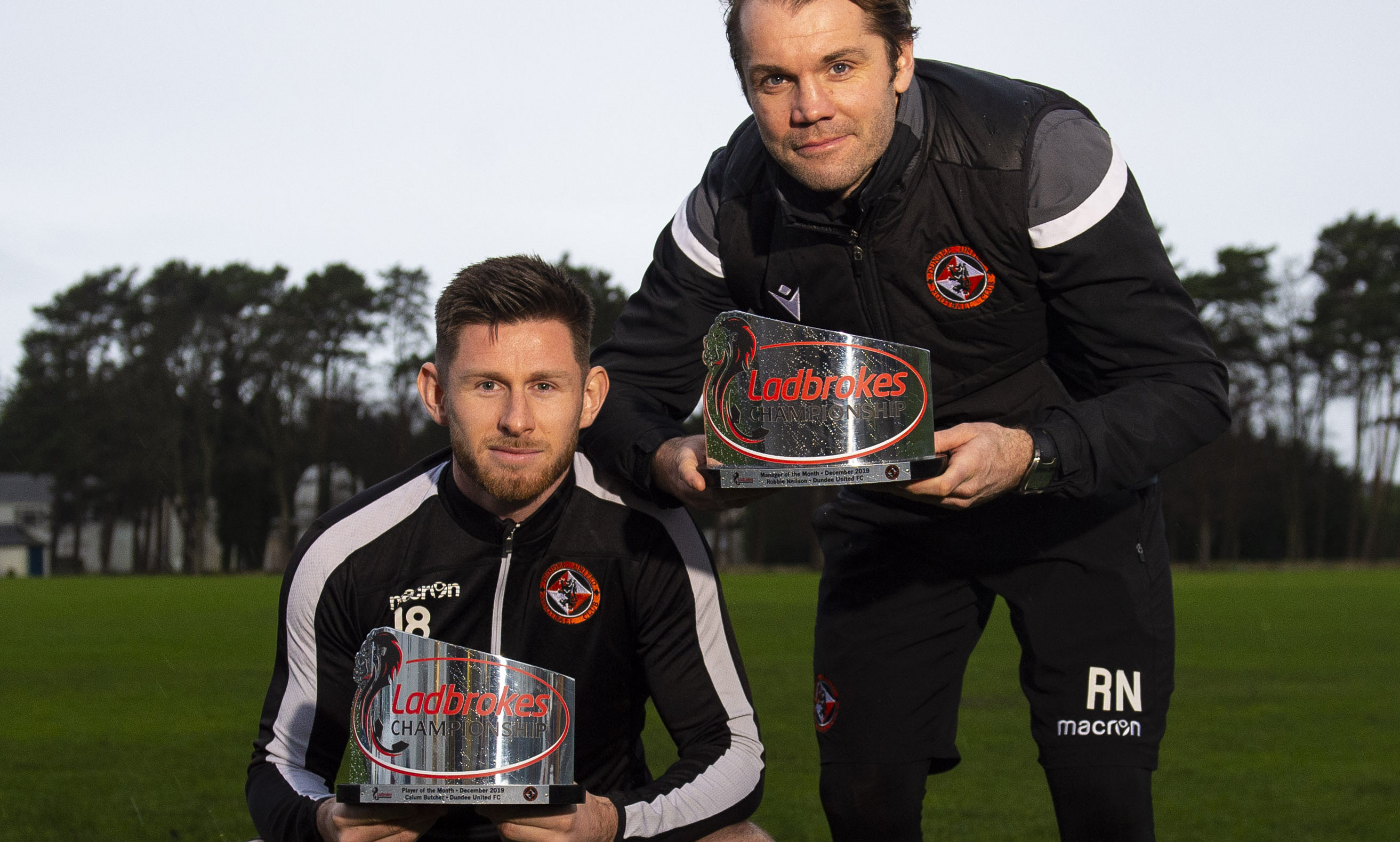 Calum Butcher (left) and manager Robbie Neilson with their player and manager of the month awards.