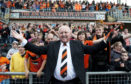 Dundee Utd legend Jim McLean celebrates with fans after a stand at Tannadice is named after him.
