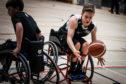 Shayne Humphries, 13, is a champion wheelchair basketball player.
