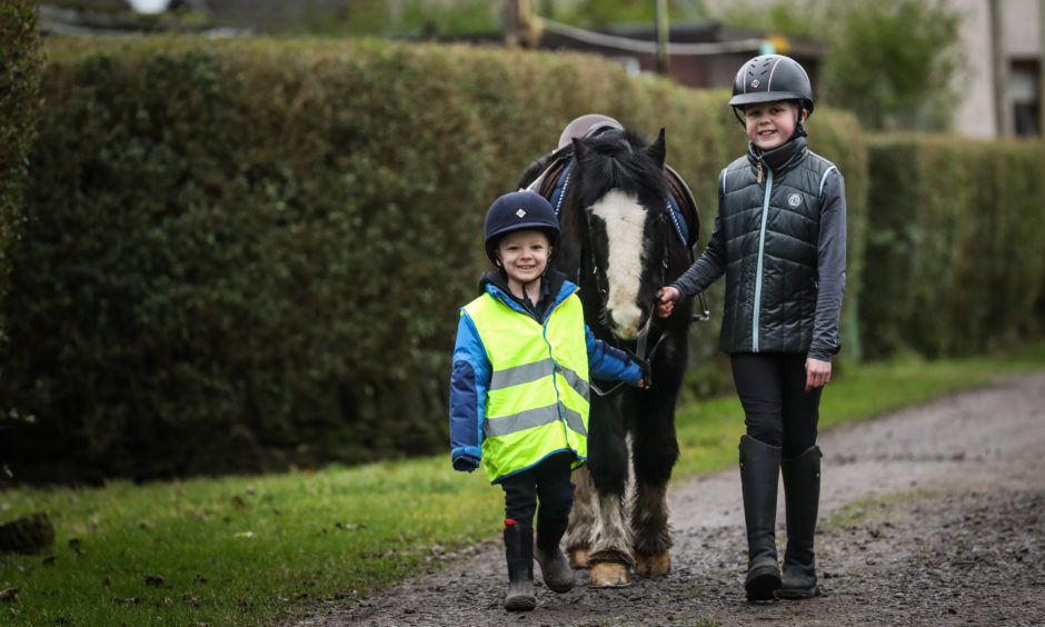 Mason MacKay, 5, the youngest rider at the centre with Daisy Walker, 10 and horse Eli.